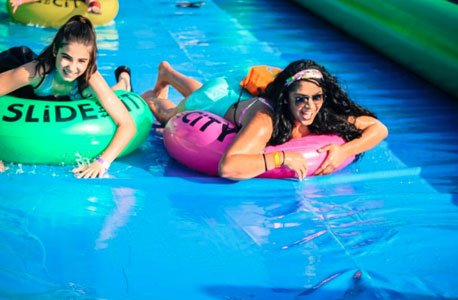 Hillen Road will be transformed into the biggest block party of the summer when Slide the City arrives on Saturday, ...