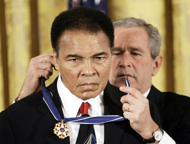 President George W. Bush awards the Medal of Freedom to Mr. Ali at a White House ceremony in November 2005.