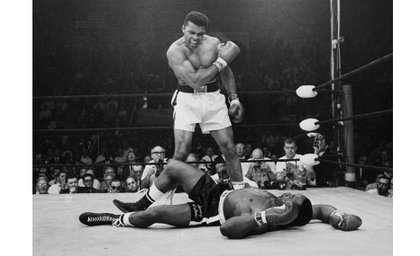 Muhammad Ali taunts Sonny Liston after knocking him out in the first round of their May 1965 rematch, three months after Mr. Ali first defeated Mr. Liston to win the heavyweight title.
