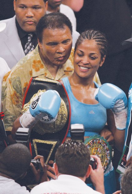 Mr. Ali proudly stands with daughter, boxing champion Laila Ali, after she won the Super Middleweight title in June 2005 at a match in Washington.