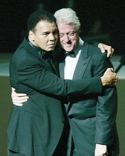 the boxing champ hugs former President Bill Clinton at a gala to open the Muhammad Ali Center in Louisville in November 2005.