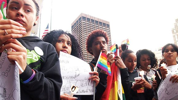 City and state officials gathered with Bostonians on City Hall Plaza in solidarity with victims and survivors of the worst ...