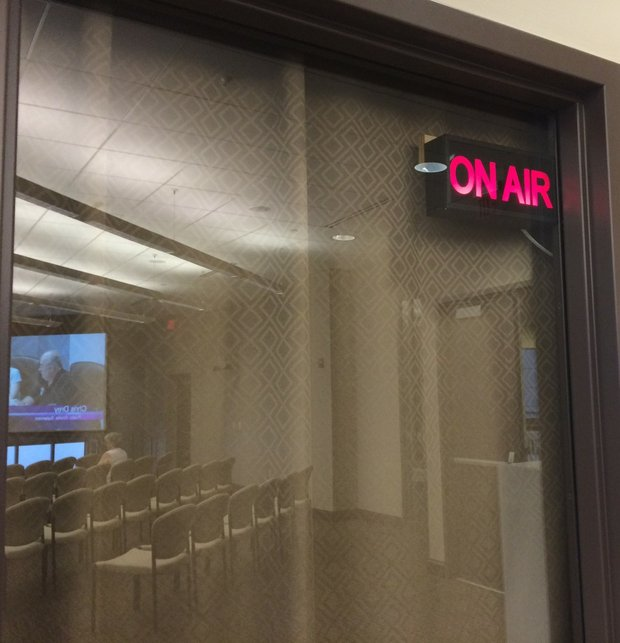 An 'on air' sign lights up as the Shorewood Village board starts its public meeting which are broadcast live over its cable access channel and over the internet.