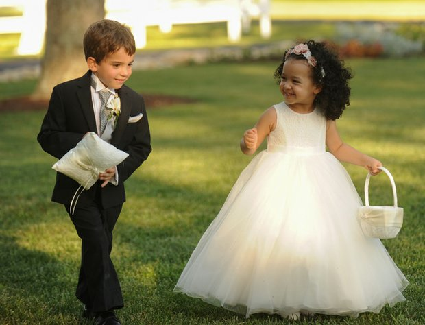 Below, Mr. Morrissey's daughter, Kennedy, 3, shares a laugh as she starts her duties as flower girl with his 7-year-old nephew, John, the ring bearer.