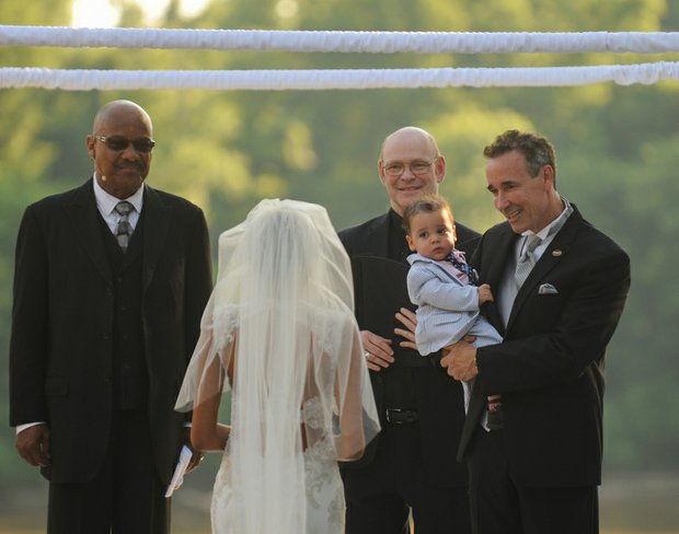 The couple's son, 15-month-old Chase, was held during the ceremony by his father.