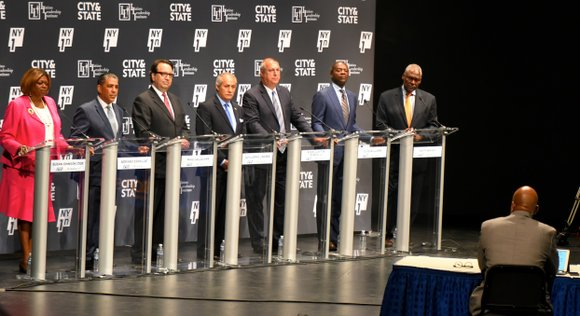 With Congressman Charles Rangel looking on, seven candidates Monday evening debated who was the best qualified to replace the 46-year ...