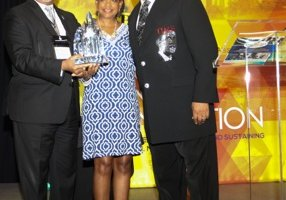 "Bobby Jones (center), host of the award-winning gospel program ""Bobby Jones Gospel,"" is presented the National Newspaper Publishers Association's Lifetime Achievement Award by NNPA President and CEO Benjamin Chavis and NNPA chair and Washington Informer publisher Denise Rolark Barnes during NNPA's annual conference at the Omni Riverside Hotel in Houston on June 23."