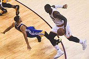 LeBron James charging at Steph Curry during game six of the 216 NBA Finals. Wikipedia photo