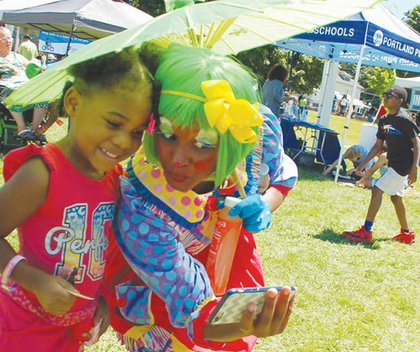 Nikki Brown Clown bonds with a youth over a cute selfie.