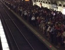 A track fire at the Gallery Place Metro station left hundreds of riders waiting on crowded platforms at the L'Enfant Plaza station on June 28. (Courtesy of Twitter via @DMVFollowers)