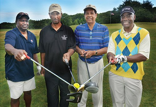 """Early-morning tee-off at the 13th annual golf tournament supporting the Prostate Health Education Network (PHEN) was held at the Franklin Park Golf Course in Boston. Joining Tom Farrington (second from right), founder and president, are (l-r) former New England Patriots Roland James and Ronnie Lippett, and Boston sportscaster """"Coach"""" Willie Maye. PHEN's mission includes advocacy efforts to increase the overall support and resources to wage a war on prostate cancer that will eventually lead to a cure for the disease for the benefit of all men."""