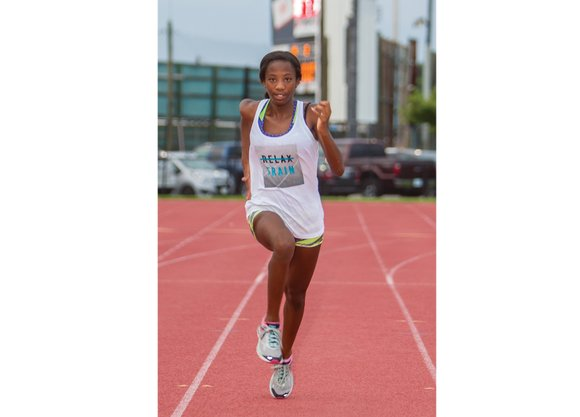 Britton Wilson draws applause in more ways than one. The 15-year-old sparkles with her fast feet on the running track ...