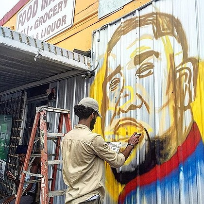 At an vigil for Alton Sterling, an artist painted a mural of Sterling on the wall outside of the store where he was fatally shot by police. Savidge posted the progression of the mural on Instagram. In the latest post, one of Sterling's sons is shown looking at a picture of his father in front of the mural. To embed:https://www.instagram.com/p/BHipD_PB_2h/ https://www.instagram.com/p/BHipD_PB_2h/ https://www.instagram.com/p/BHiPmvABgf3/
