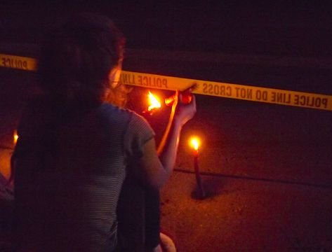 While some who gathered at the scene of the shooting of 32-year-old Philando Castile were highly vocal, yelling to the police, many were somber, holding signs and candles. (Photo: Harry Colbert, Jr./Insight News)