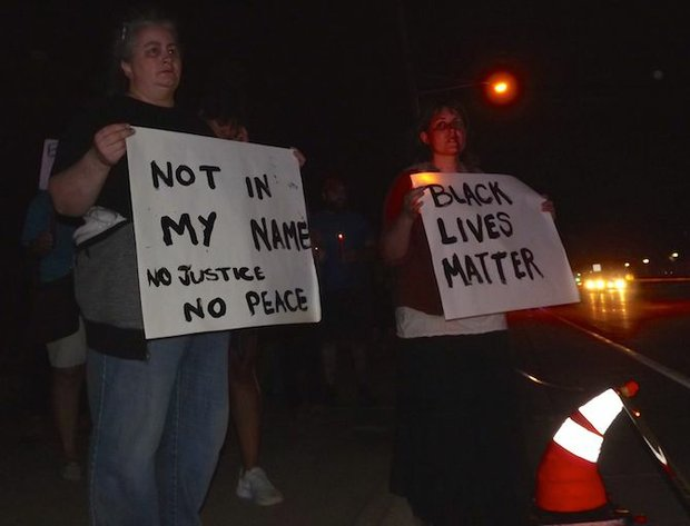 Protesters remained on the scene of the officer-involved shooting of 32-year-old Philando Castile until investigators concluded their work, approximately 1:45 a.m. Thursday morning. Castile and his girlfriend were stopped for a broken taillight in Falcon Heights, near the gates to Minnesota State Fair grounds. (Photo: Harry Colbert, Jr./Insight News)