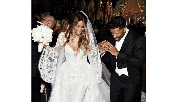 Singer Ciara has one-two stepped down the aisle with NFL player Russell Wilson. The couple both posted the same photo ...