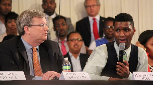 Memphis Mayor Jim Strickland listens as Black Lives Matter activist DeVante Hill lays out a list of demands at a hastily organized public forum Monday afternoon. The forum follows an impromptu Sunday march in which hundreds of protestors shut down the I-40 bridge for five hours. (Photo: Lee Eric Smith)