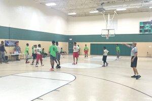 Teens play basketball at the Gresham Park Recreation Center as part of the DeKalb County PAL Plus Midnight Basketball Summer League.