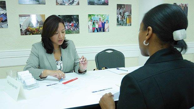 Shamia Hicks (right) interviews for a hotel job during a job fair.