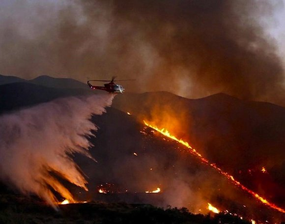 Fanned by scorching heat, windy conditions and a five-year drought, a pair of California wildfires has burned tens of thousands ...