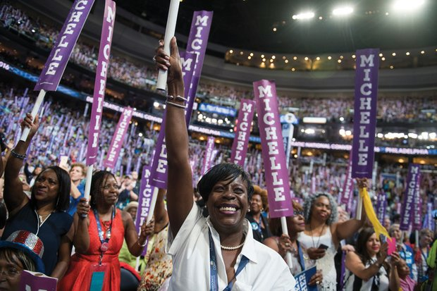 Delegate Cherelle Parker of Pennsylvania, center, cheers First Lady Michelle Obama at the Wells Fargo Center in Philadelphia on the opening day of the Democratic National Convention.