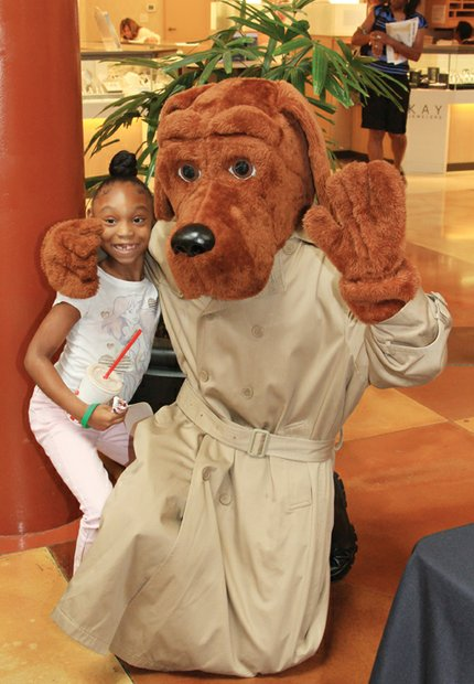 DeKalb School System's McGruff the Crime Dog posed with a young fan.