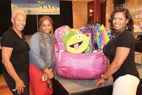 CrossRoadsNews Editor and Publisher Jennifer Parker (left) and expo emcee Lillie Shaw-Lomax (right) pose with grand prize winner Mekia Taylor.
