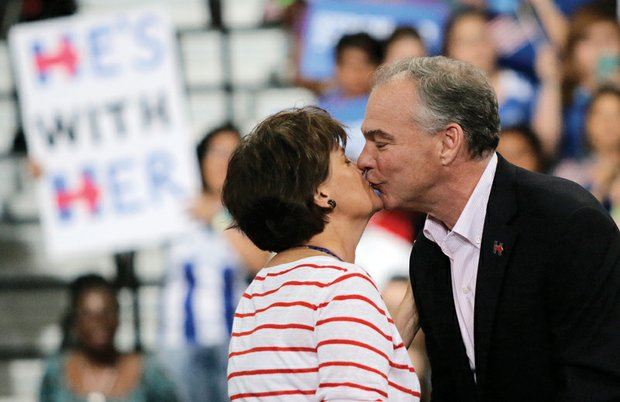 Sen. Kaine gives his wife, Anne Holton, a kiss in response to her glowing introduction at Monday's rally.