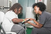 Yodit Berhane, an optical technician with Northern Virginia Doctors of Optometry, examines Caleb Smith, 9, during the VSP Global Eyes of Hope mobile eye-care clinic held at the Nationals Youth Baseball Academy in southeast D.C. on Aug. 4.