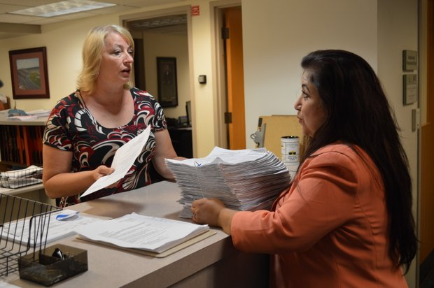 Concerned Citizens for Joliet chairperson Maria Aracelia Rosas-Urbano turned in the ballot signatures to the city clerk's office this week.