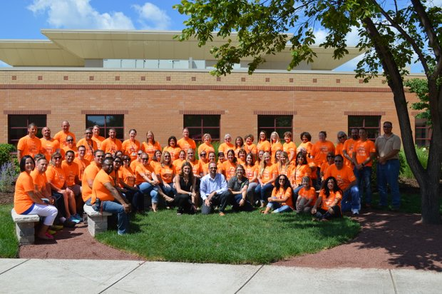 Lukancic Middle School teachers pose in the district's first outdoor classroom space created in the Romeoville school's courtyard.