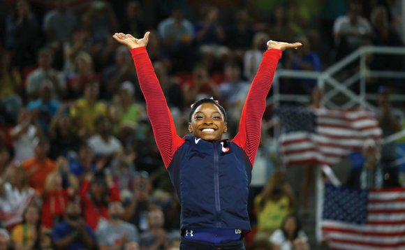 Simone Biles showed off her sassy moves and explosive tumbles on the floor exercise to win a record-equaling fourth gold ...