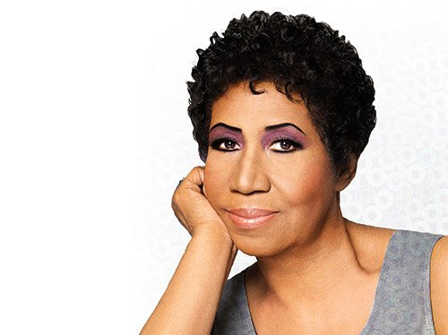 Performing a career-spanning set of hits with power and joy, Aretha Franklin held her audience in thrall.