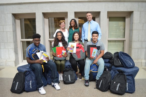 Diageo employees recently presented a donation of 25 backpacks with supplies to Joliet Central High School's Key Club as the ...