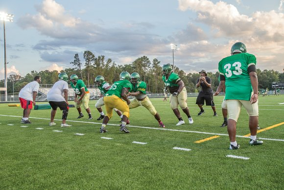 Huguenot High School's 2015 football Falcons were either 2-8 or 8-2, depending on whether you attended games on Friday or ...