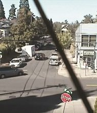 Surveillance video from a camera across the street the Alberta Market at Northeast Alberta and Ninth Avenue shows cars and people caught up in a shooting that police believe is gang related. The video was released by police in an attempt to solve the crime.
