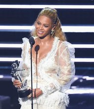 Beyonce accepts the award for Video of the Year for 'Lemonade' at the MTV Video Music Awards in New York City on Sunday.  (AP photo)