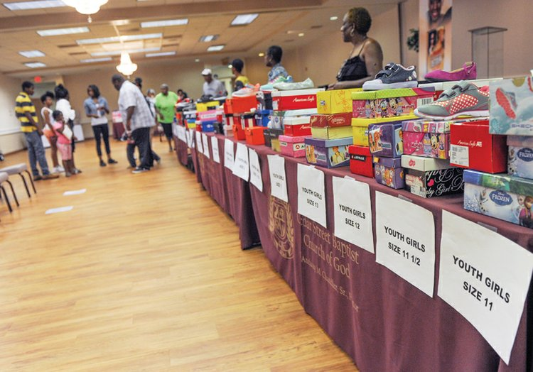 Annual Labor Day back-to-school shoe giveaway at 2 sites