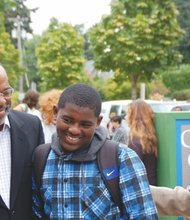 Incoming eighth grader Ruebens Francois gets a helping hand on his first day back to school at Ockley Green Middle School in north Portland from adult mentors from Portland's Coalition of Black Men, Chairman Ralph Evans (left) and former Executive Director Bruce Watts.