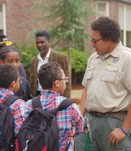 Boy Scouts of America District Executive and former Peace Corps advisor Jonathan Malloy joins Coalition of Black Men members to greet and encourage the success of students entering Ockley Green Middle School in north Portland on the first day of classes for the new school year.