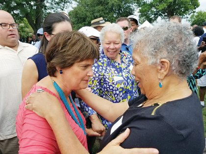 Anne Holton, left, and Free Press President-Publisher Jean P. Boone greet one another and pause to talk at the annual Labor Day Cookout.