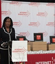 Jackie Joyner-Kersee, an official spokeswoman for Comcast's Internet Essentials Program with David L. Cohen, Senior Executive Vice President and Chief Diversity Officer of Comcast Corporation (seated), at the official kick-off of the six-year program announcement in Chicago on Wednesday, August 24, 2016.
