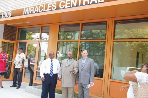 Miracles Central, a new affordable housing complex in the Lloyd District opens to people impacted by homelessness, poverty and addictions. Pictured at Thursday's grand opening ceremony are Robert Lyday (from left), one of the first residents to move into the 47-unit building, Michael Booker, Miracles Club executive director, and Portland City Commissioner Dan Saltzman.