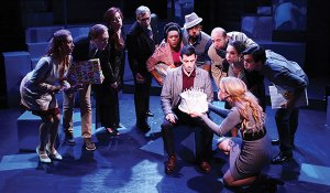 "Actor John Ambrosino (center) and fellow cast members from ""Company."""