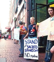 Demonstrators rally outside of a TD Bank branch in Central Square, protesting the bank's financing of the Dakota Access Pipeline, which would cut under the Missouri River just above the Standing Rock reservation.