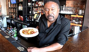 Joe, a bartender at Po Bo Jim's, shows off the restaurant's acclaimed New Orleans-style gumbo. (Howard University News Service)