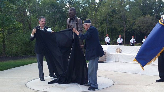 The new statue of Abraham Lincoln was unveiled at the national cemetery in Elwood that also bears his name.