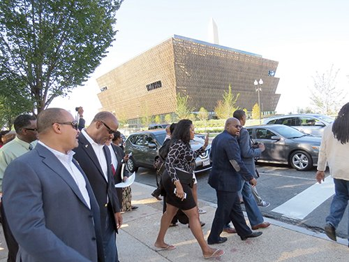 Members of the National Newspaper Publishers Association make the trek to the National Museum of African American History and Culture (center) during Media Preview Day on Sept. 14.