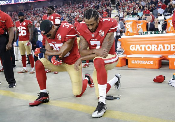 Colin Kaepernick and Eric Reid once again kneeled during the national anthem before the San Francisco 49ers' season opener Monday ...