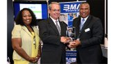 John Finger (left) of Baptist Memorial Healthcare receives an award from Shon Akiens (right) of BMA Transports, Inc. (Photo: Gary S. Whitlow)